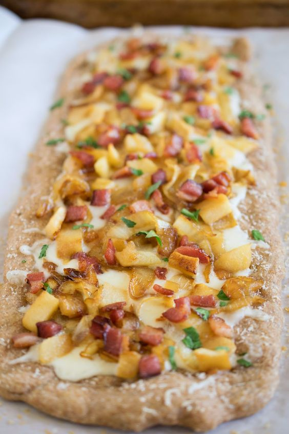 Sweet caramelized onions and apples, smokey bacon and creamy fontina cheese with whole wheat dough. This flatbread pizza a delicious meal or appetizer for the thin crust pizza lover.