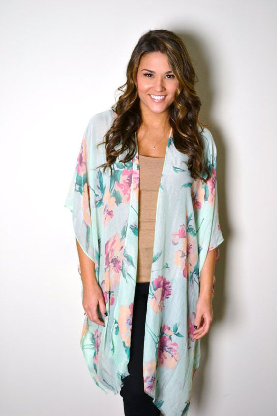 We adore this floral kimono. It has sleeves for easy wear. Great butt coverage :) Lightweight and airy. Great for over a dress, or even a bathing
