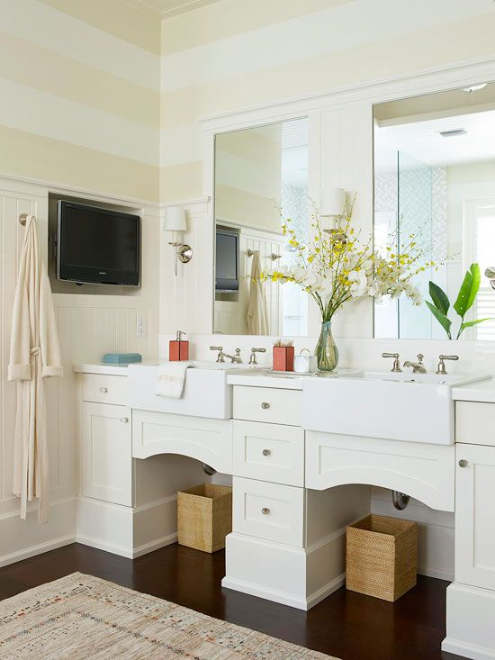 Watch the news or your favorite TV show while getting ready with a water-resistant television. More bathroom upgrades: http://www.bhg.com/bathroom/remodeling/planning/our-favorite-bathroom-upgrades/?socsrc=bhgpin100313tv&page=7