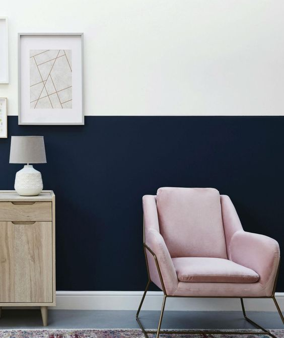 To create a sophisticated hallway, pair crisp white with deep navy for a two-tone statement wall. Use the white paint on the top half of the wall to add space and height to your entrance. #homedecor Click for more amazing paint effects to transform your home's walls. Image: Next