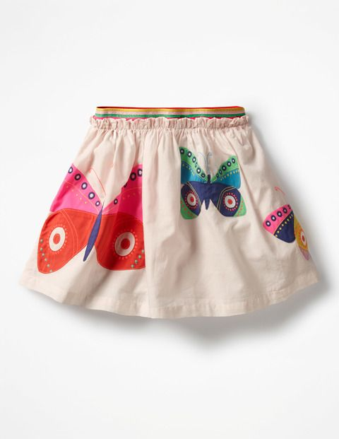 Butterflies in the garden or surfing at the beach? This is the skirt that summer dreams are made of; pop it on for parties (or just any day of the week). This embroidered delight even has a bright rainbow stripe waistband and neon threads running through the frills. Swish away!