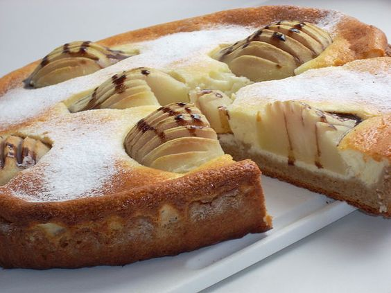 Curd dessert with pears on a chocolate dough