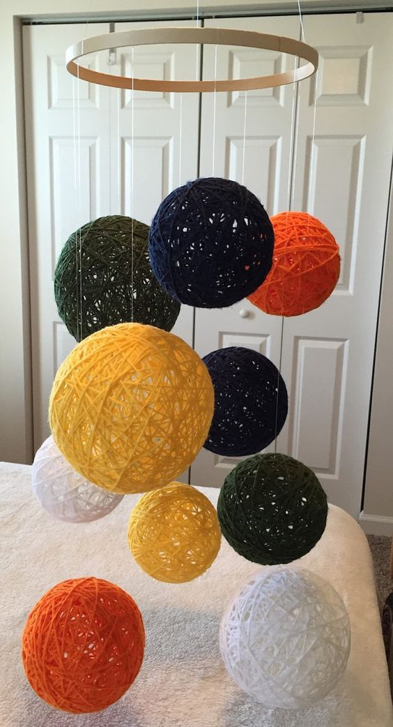 Yarn ball baby mobile in navy blue olive by Backporchcrafts85: