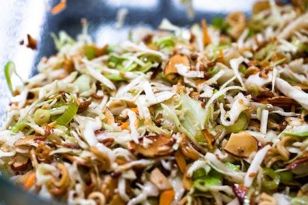 Asian Cole Slaw - this stuff rocks!  FYI - I toast the almonds and sesame seeds in the oven and omit the butter.  It makes me feel better about eating it ALL.