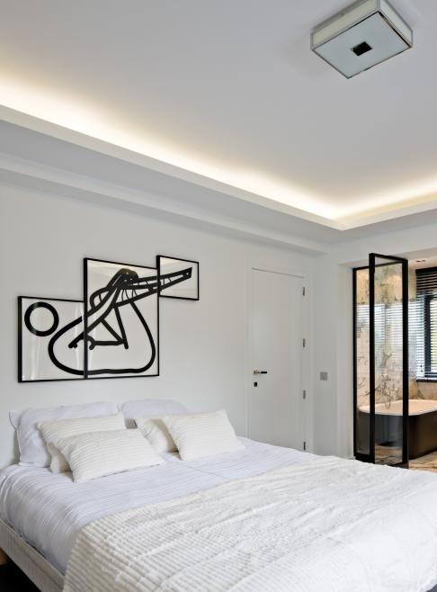 lichtkoof met indirecte verlichting naar plafond slaapkamer