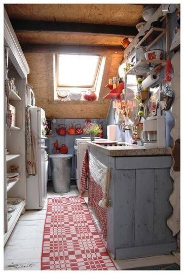 Tiny European country kitchen with blue and red. #smallkitchen #europeancountry #rustic