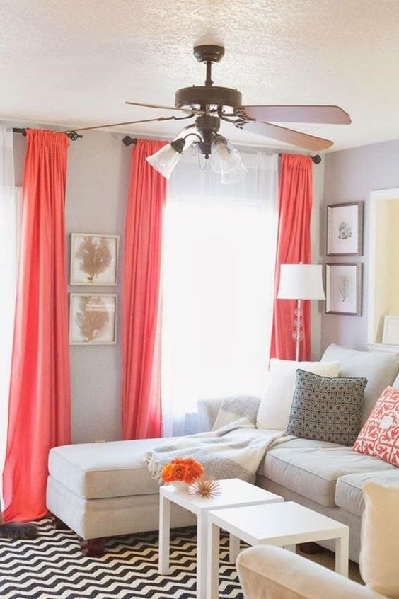 A Living Room With Dove Grey Walls Coral Curtains And Pillows A Creamy Sofa And White Coffee Curtains Living Room Living Room Decor Curtains Coral Home Decor