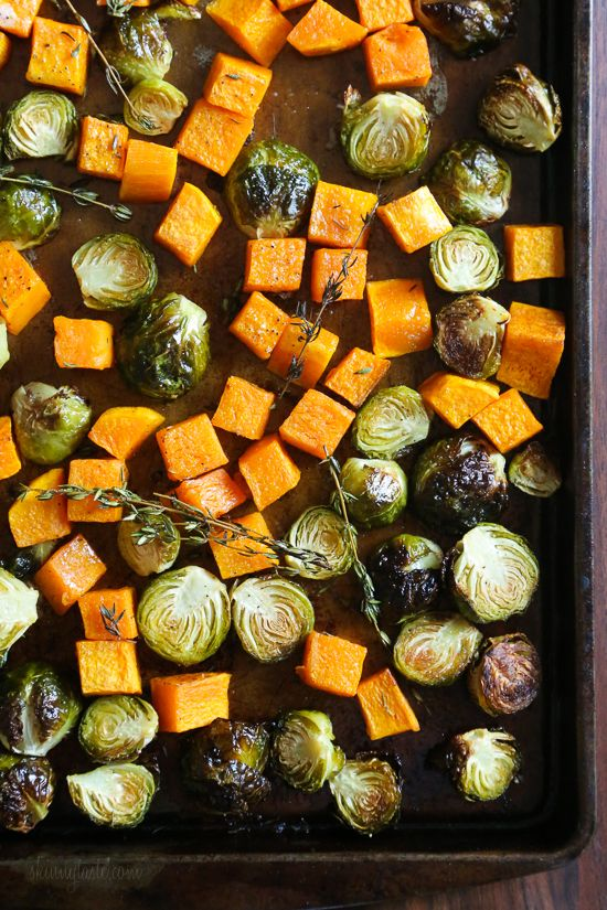 Roasted Brussels Sprouts and Butternut Squash are tossed with olive oil, salt and pepper for an easy Fall side dish! Simply place them on a sheet pan and bake until tender and the Brussels are slightly charred on the edges.