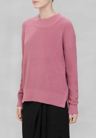 A knitted sweater made from pure cotton, featuring a wide collar and slightly elastic cuffs.