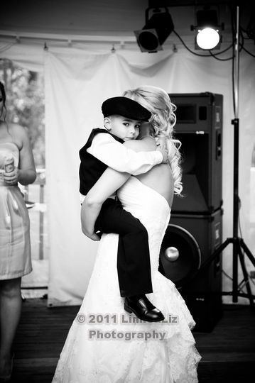Bride dancing with the ring bearer. http://linnealizphotography.com