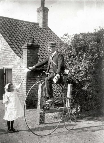Postman on a penny farthing