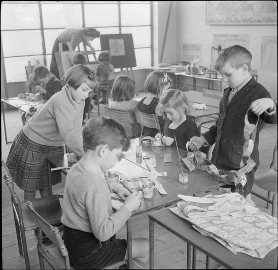 Pupils at Fen Ditton Junior School in Cambridgeshire make Christmas decorations in 1944. The children in this photograph are creating paper chains, a popular Christmas decoration. In wartime, these would be made from scraps of old paper or painted newspapers. Very few decorations were available to buy in the shops. (Imperial War Museum)