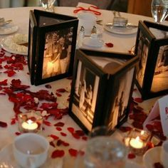 Glue 3 picture frames together with no backs, then place a flameless candle inside to illuminate the photos - love (CUTE idea for [FALL] wedding centerpieces)