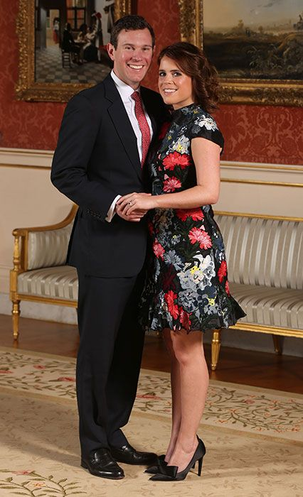 Princess Eugenie wears a short -sleeve floral print dress with pointed-toe black pumps to announce her engagement.