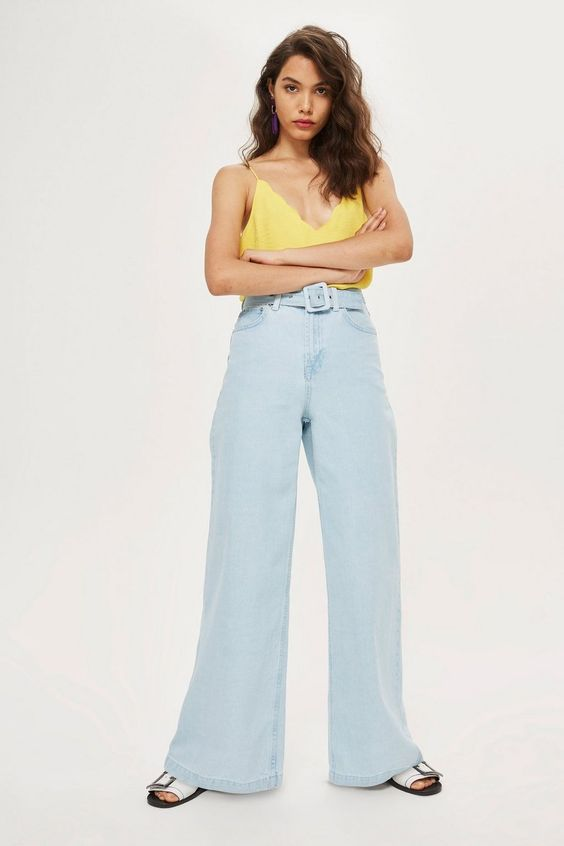 Topshop Pale Blue Flared Denim Jeans. Fashion Bloggers: Presenting the flared #jeans you need in your life. Style with a yellow camisole and flatform sandals for the ultimate #summer #weekend #outfit. Shop at THECLCK.COM