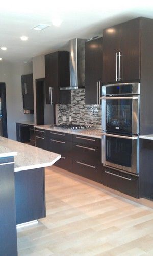 Marla Baird Contemporary Kitchen Within Dark Cabinets Light Wood Floors And White Tone Countertop