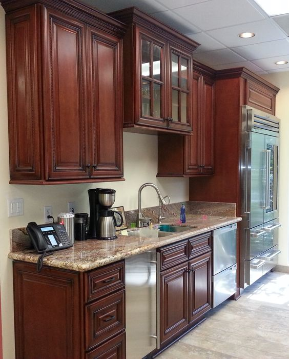 Red Cherry Rope cabinets with decorative end doors and Typhoon Bordeaux granite.