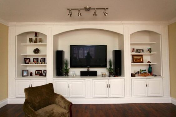 Traditional shelves and tvs on pinterest for Built in entertainment center using kitchen cabinets