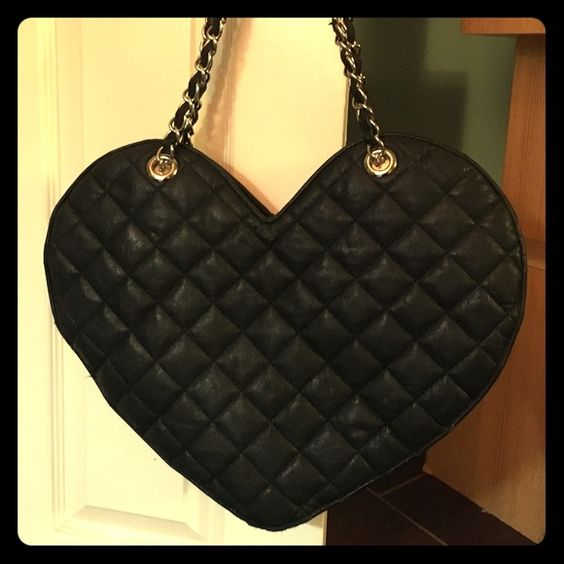 Heart shaped black purse Super fun heart shaped purse has some wear and tear for average use. bebe Bags Shoulder Bags