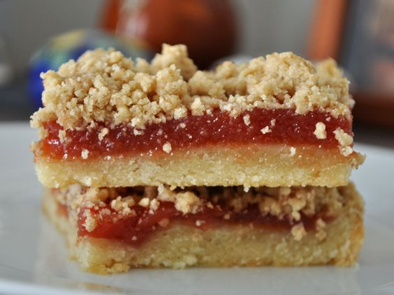 Guava Bars  Carrie Vasios      BAR COOKIES  COOKIE MONSTER  COOKIES  GUAVA  OATS  SHORTBREAD  PRINT  FAVORITE THIS! (7 )  EMAIL                  In these tropical bar cookies, a buttery shortbread base is topped with sweet guava paste, then finished with a lightly crunchy oat topping.