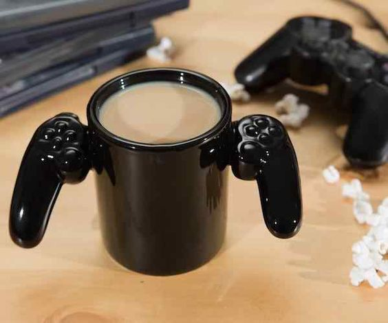"If you are a game addicted person, this is the great gift for you. This will add extra gaming fun to your coffee times and it's amazingly designed with video game controller handles that bring the gaming spirit when you sip coffee on this. It holds 12 ounces of liquid and the inside of this mug has ""Game Over"" imprinted in green letters. You can also gift it to your game lover friends. - Price $19.75"
