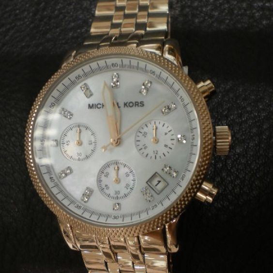 Love this rose gold MK watch.