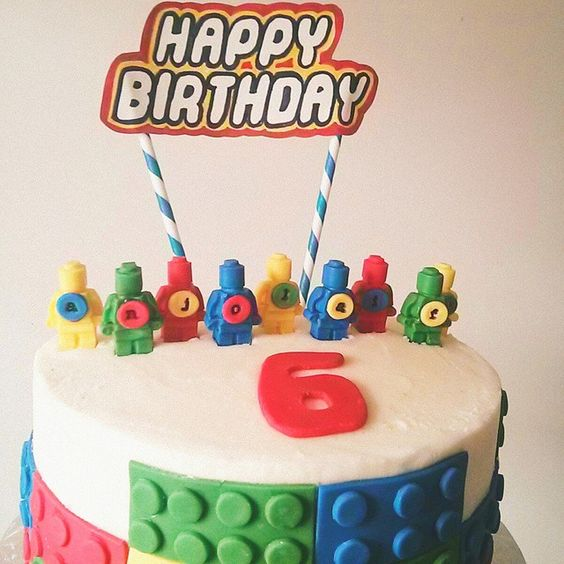 Buttercream Lego cake with fondant accents and hand drawn banner. Made for a special 6 year old boy By Evie and Mallow