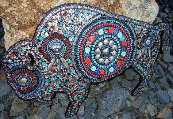 This is a wooden cut-out wall hanging of a magnificent buffalo measuring 24 x 16 that has been elaborately decorated in a Southwestern theme.