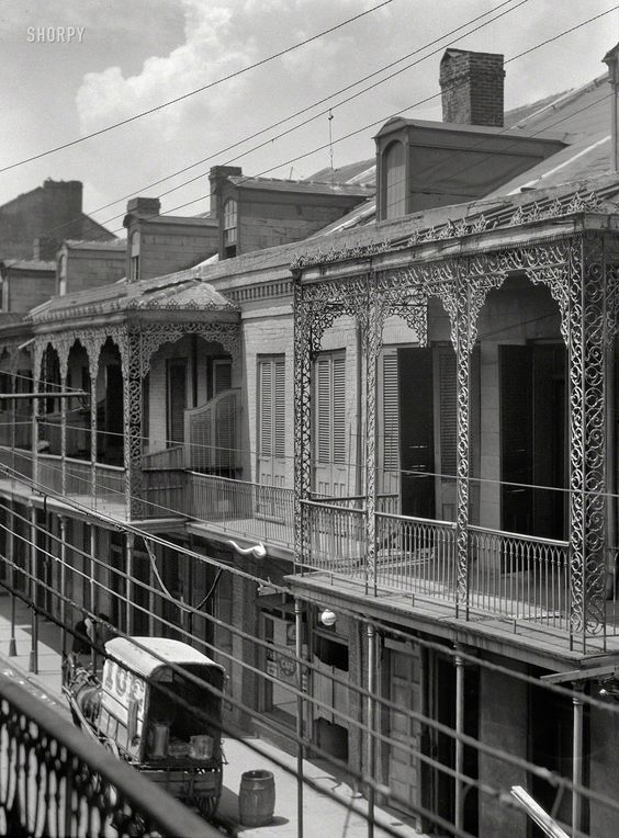 Upper stories of buildings with wrought iron balconies for Balcony history