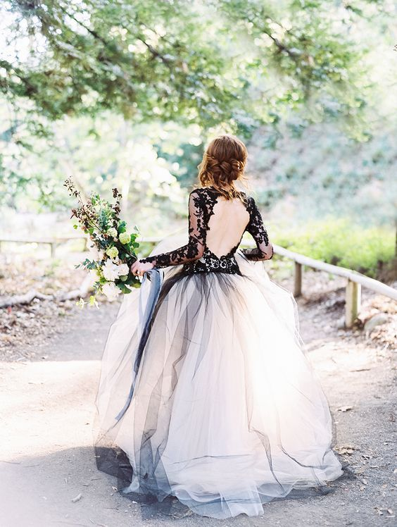 tulle wedding dress with black lace sleeves / http://www.himisspuff.com/black-wedding-dresses/7/: