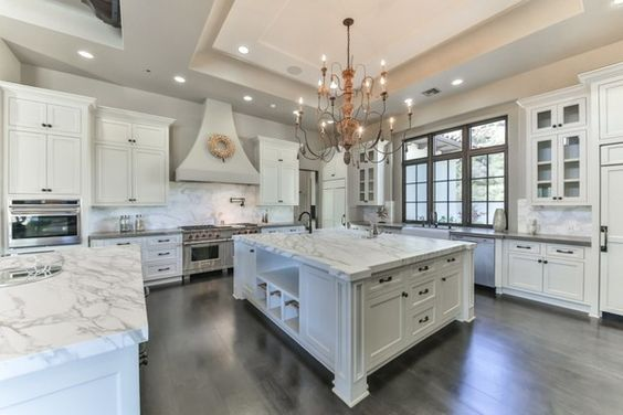 Work Kitch   The light and airy kitchen features state-of-the-art appliances nestled among thick slab marble countertops and white cabinetry.