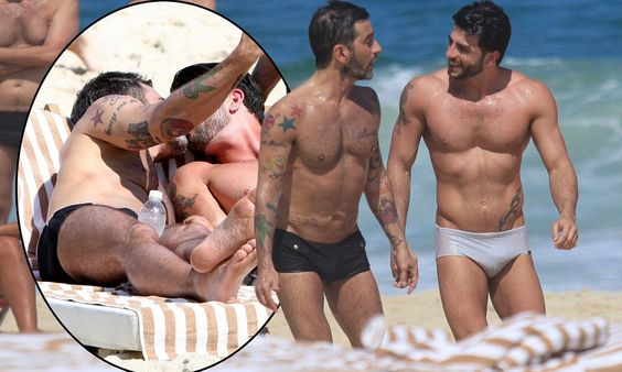 The boys from Ipanema: Marc Jacobs and porn star beau Harry Louis enjoy a very amorous day at the beach