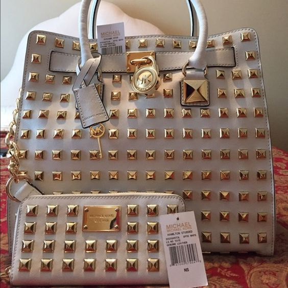 Michael kors handbag Michael Kors studded Hamilton handbag 100% authentic! BRAND NEW IN PERFECT CONDITION!!! It was given to me as a gift! The structure is perfect no creasing, marks, or stains! Price is for the handbag? Michael Kors Bags Totes