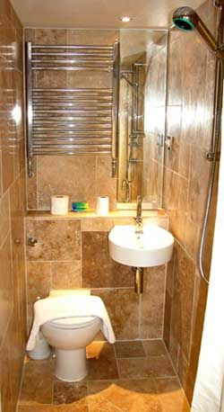 Small Wet Rooms - This is another small space solution. The bathroom (wet room)  floor has a drain and what looks like a 2-piece bath but it is a shower room too!:
