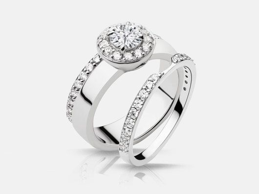 Amica style engagement ring set with 28 halo and side round brilliant diamonds totaling 0.42 carats in 18k white gold.