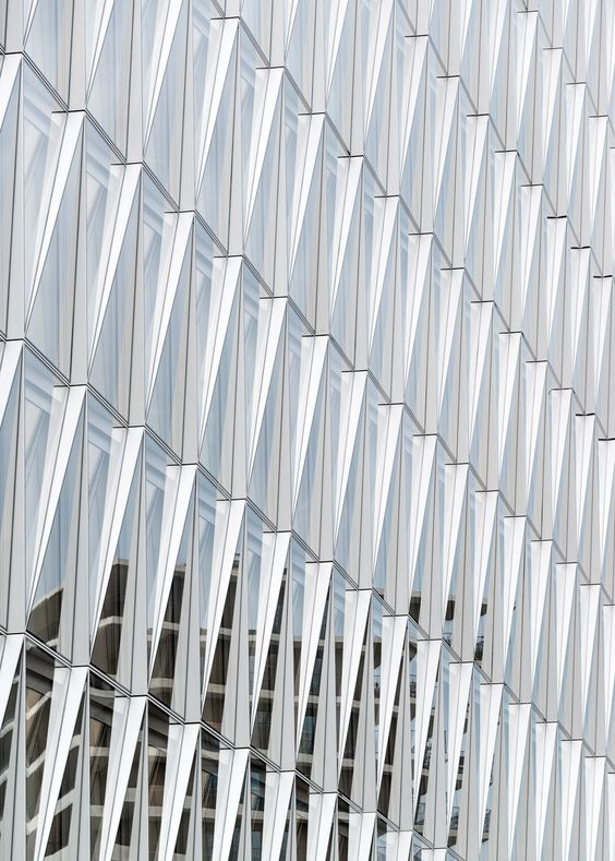 JTI Headquarters in Geneva by SOM has a facade of glass triangles