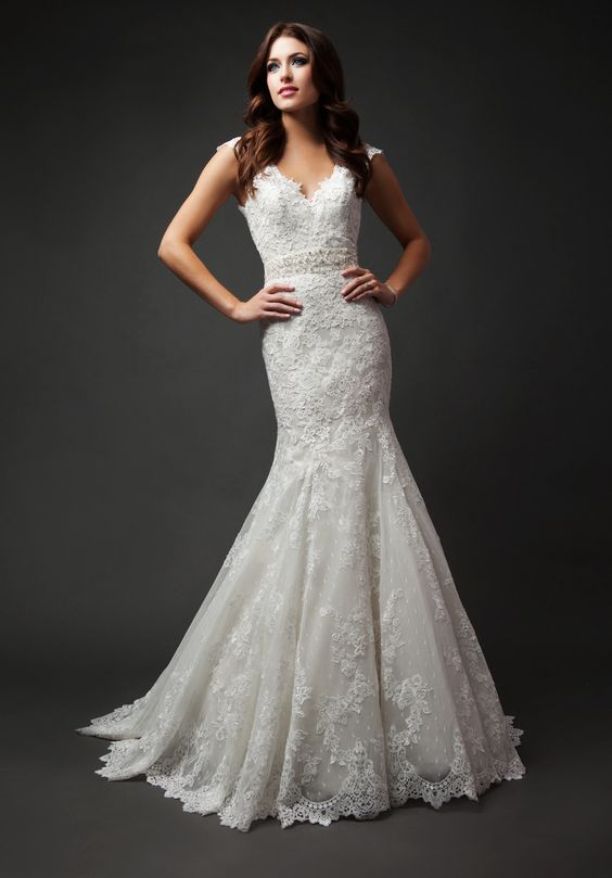 Kenneth Winston Style 1573 featured in Arkansas Bride's 25th Anniversary Issue. If you're a fan of lace, this dress is it!
