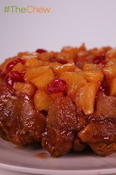 Pineapple, coconut, and cherries make for a tasty easy Pineapple Upside Down Monkey Bread dessert by Carla Hall you won't want to miss! #TheChew