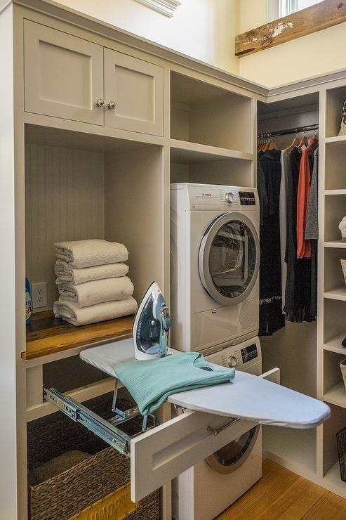 This Laundry Closet Showcases Unique Organization Features From A Pull Out Iron Board Dra Laundry Room Closet Laundry Room Storage Shelves Modern Laundry Rooms