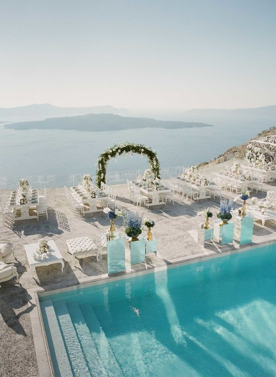 All hands on deck to admire this elegant blue and white wedding in stunning Santorini!