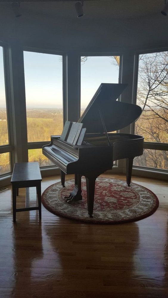 Antique Chickering baby grand piano