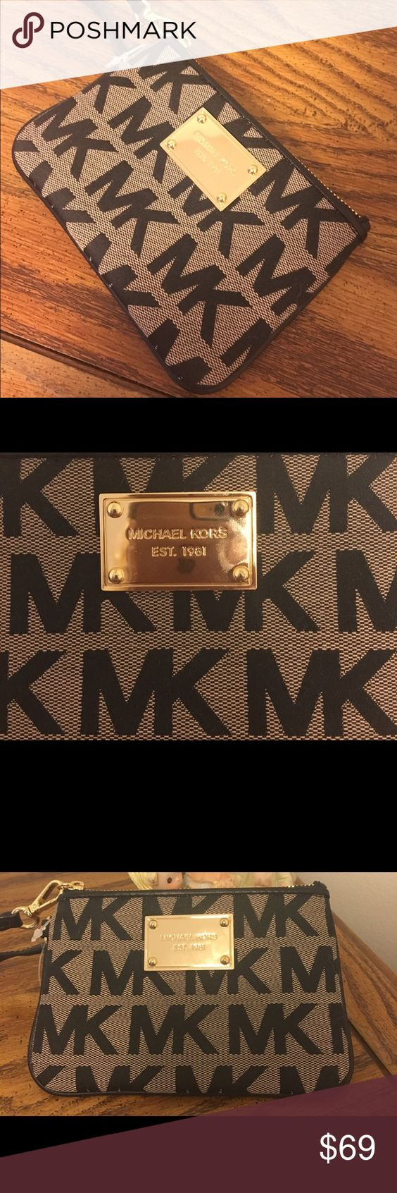 "SALE!! NWOT Michael Kors black & beige wristlet 1 DAY SALE!!! Michael Kors beige & black wristlet with black leather trim & gold hardware on the front of the purse.  Perfect for any occasion!! Measures 6"" in length & 4"" in height Michael Kors Bags"