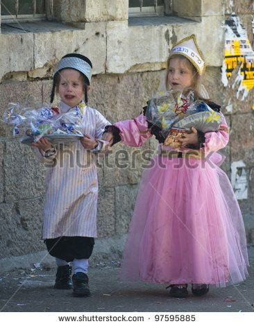 JERUSALEM - MAR. 09 : Ultra Orthodox children holding Mishloach Manot during Purim in Mea Shearim Jerusalem