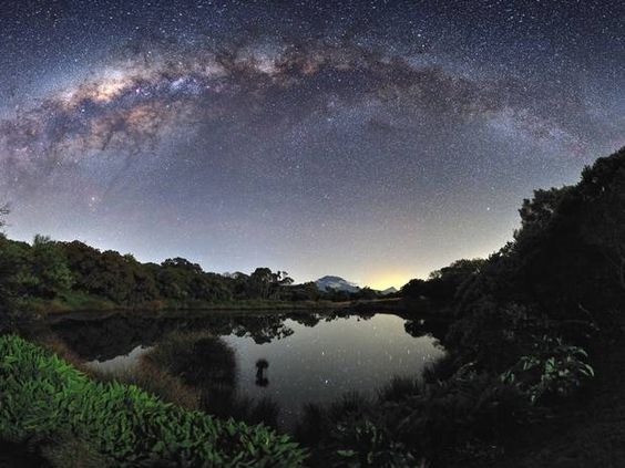 The Milky Way View from the Piton de l'Eau, Reunion Island, by Luc Perrot (Reunion Island): Highly commended in the Earth and space category. The Milky Way arches over a mirror-like lake on the island of Reunion. At the bottom of the picture Piton des Neiges, the highest peak of Reunion Island, can be seen.