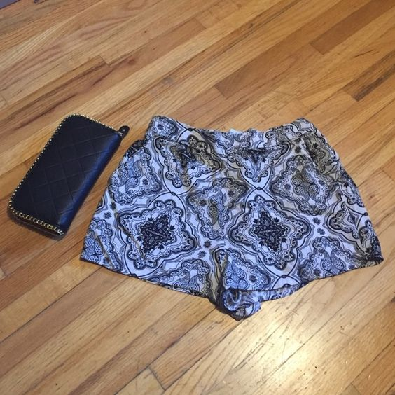 Charlotte Russe shorts Black and white print shorts. Soft material, stretchy waistband. Cute for the summer with a tank top or layer with tights and a sweater in the fall. Charlotte Russe Shorts