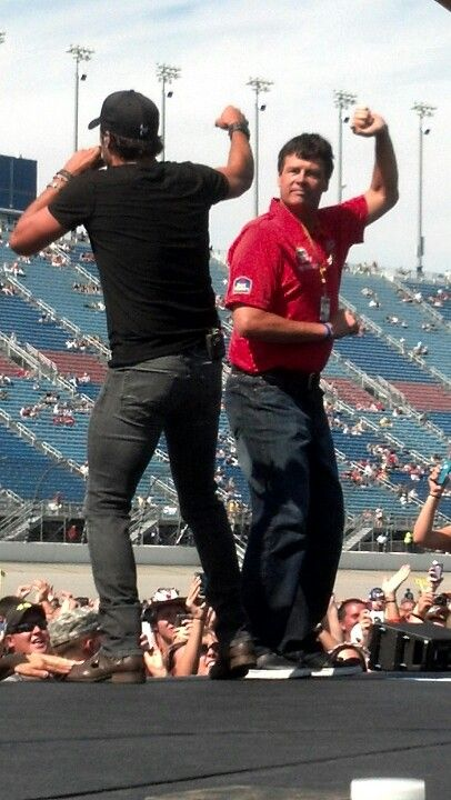 My hubby took this pic of Michael Waltrip & Luke Bryan -- Shake it for me!