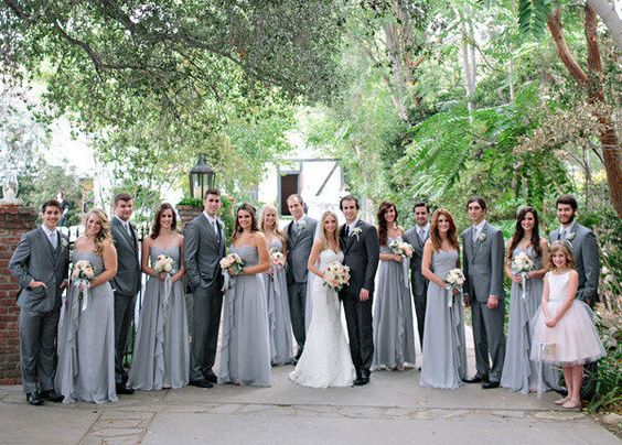 The wedding party is more spread out instead of the usual all smooshed together look, can see everyone together and there's more depth to the photo