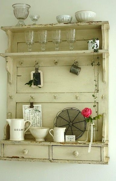 upcycled door turned into a great wall display shelf with drawers & knobs