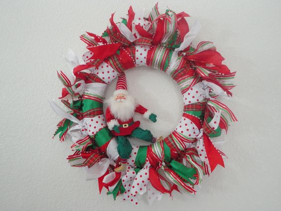Wrap a styrofoam wreath with a variety of great ribbons tied in a knot at the sides.  Trim the edges about the same length.  Add a cute Santa....voila!   Great for a door....lightweight...easy to pack away!