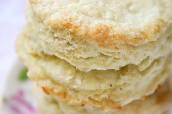 Fat, Flaky Buttermilk Biscuits  4 cups all-purpose flour  4 teaspoons baking powder  1 teaspoon baking soda  1 teaspoon salt  12 tablespoons cold unsalted butter, cut into cubes  1 1/2 cups cold buttermilk  1/2 cup heavy cream  4 tablespoons butter, melted, for brushing over biscuits